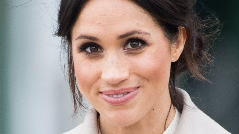 Meghan Markle smiles at an outing