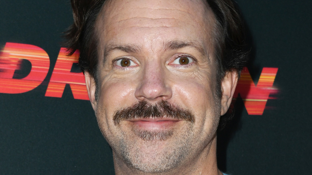 Jason Sudeikis smiling with wide eyes