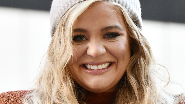 Lauren Alaina wearing hat and smiling at the Macy's Thanksgiving Day Parade in 2020
