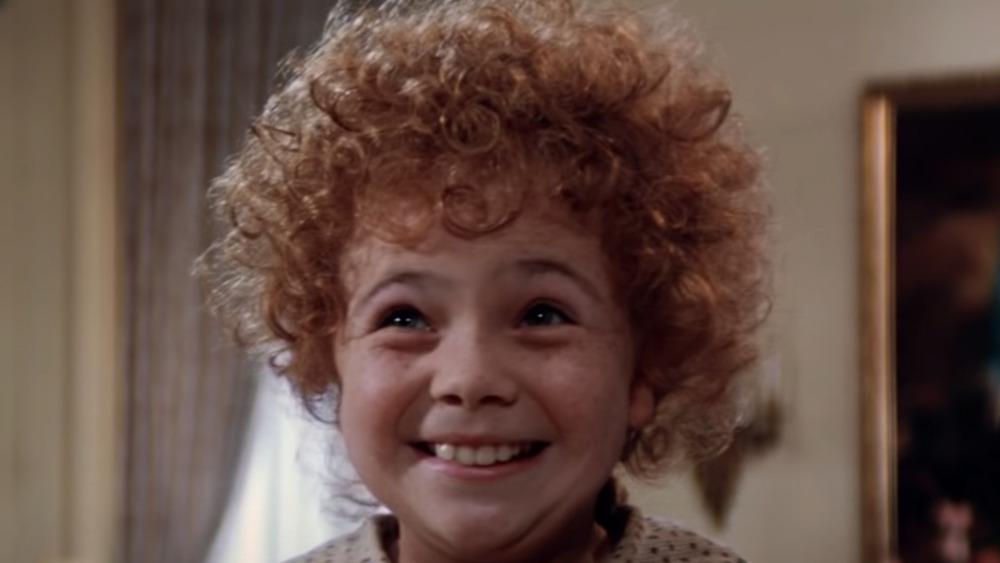 Aileen Quinn smiling as Annie