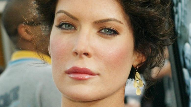 Lara Flynn Boyle poses with raised eyebrow