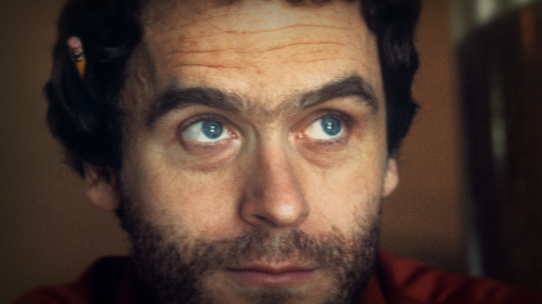 Ted Bundy looking up pencil in ear