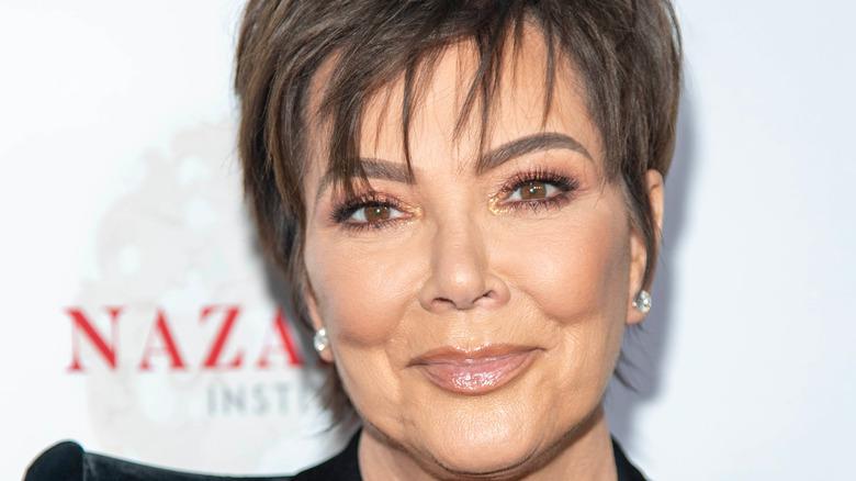 Kris Jenner piecey bangs neutral lipgloss
