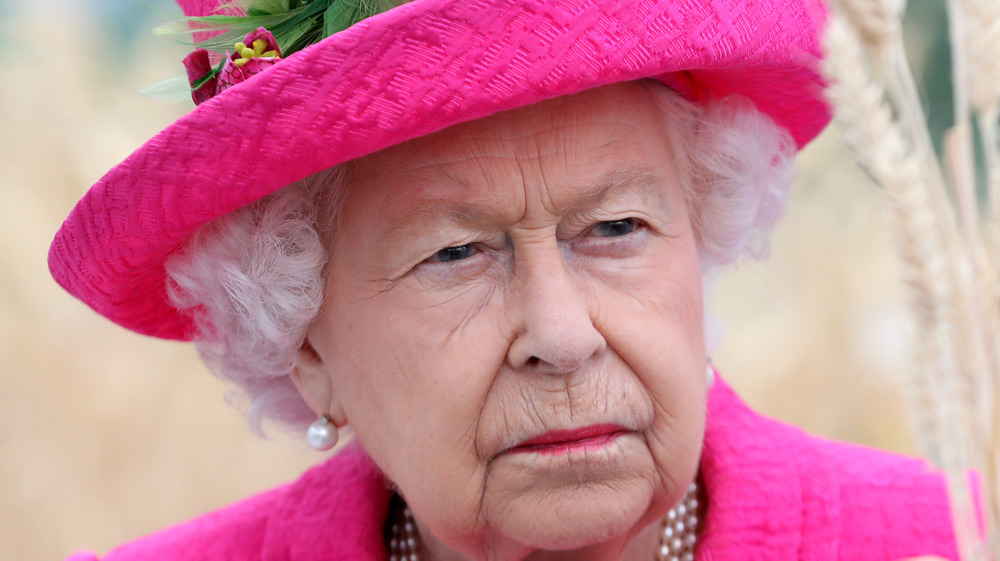 The Queen frowning at a royal event