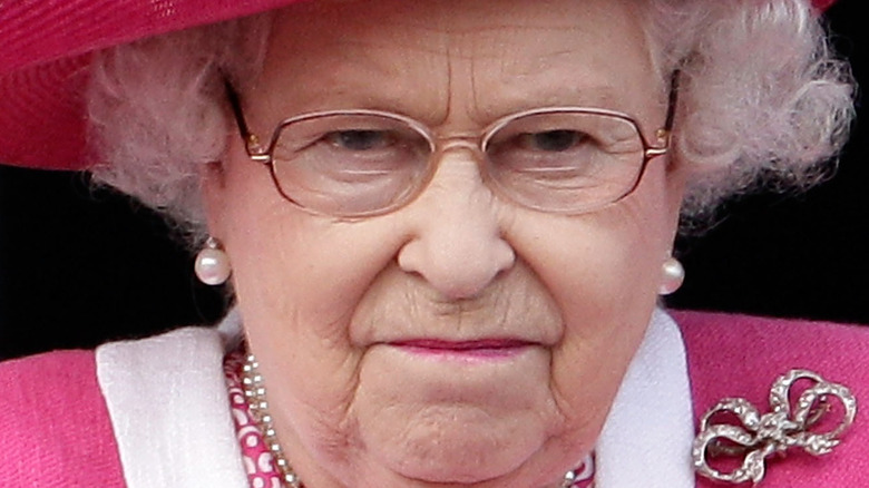 Queen Elizabeth at event frowning