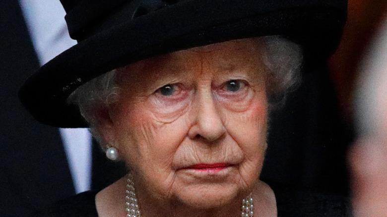 Queen Elizabeth II at a funeral