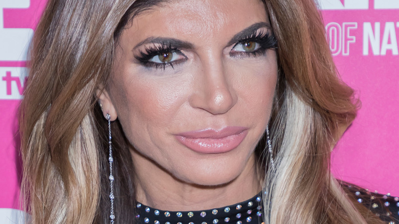 Teresa Giudice smiling and looking to the side