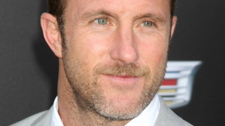 Scott Caan looking to the side with slight smile