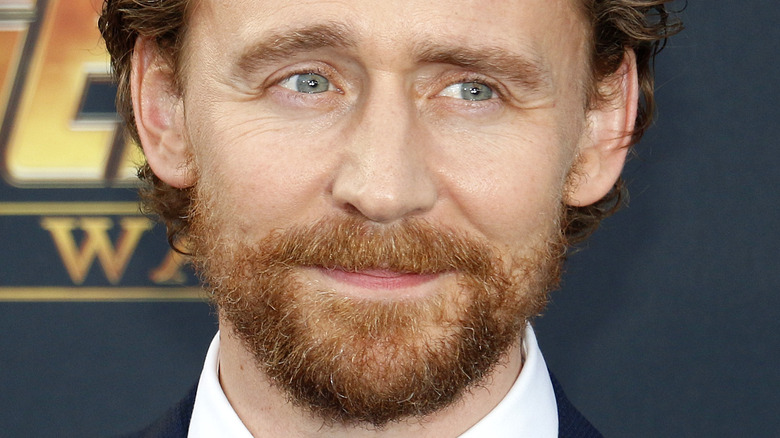 Tom Hiddleston bearded and smiling