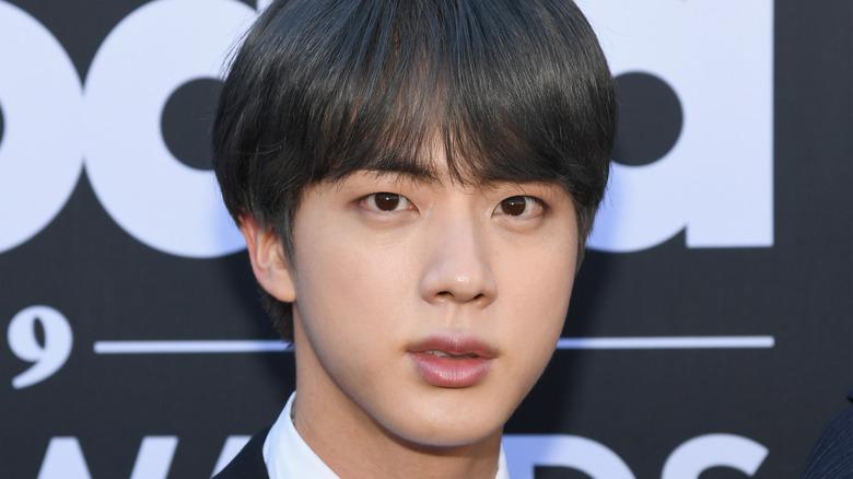 Jin of BTS, not smiling, 2019 award show red carpet