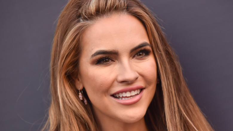 Chrishell Stause smiling at a red carpet event