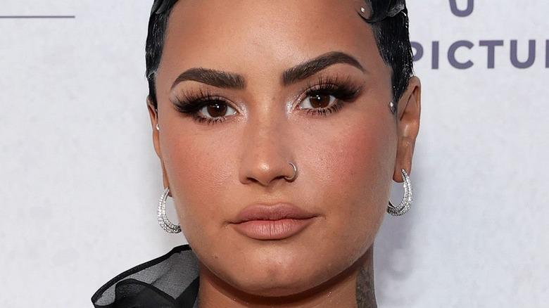 Demi Lovato staring at camera