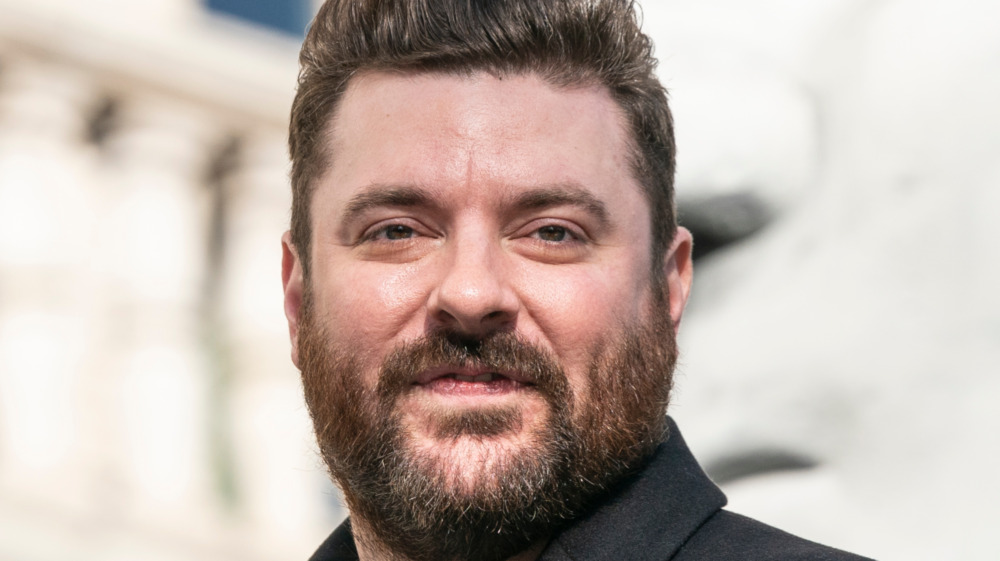 Chris Young gives a slight grin at a public event in 2019