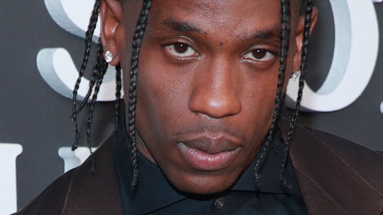 Travis Scott with a serious expression