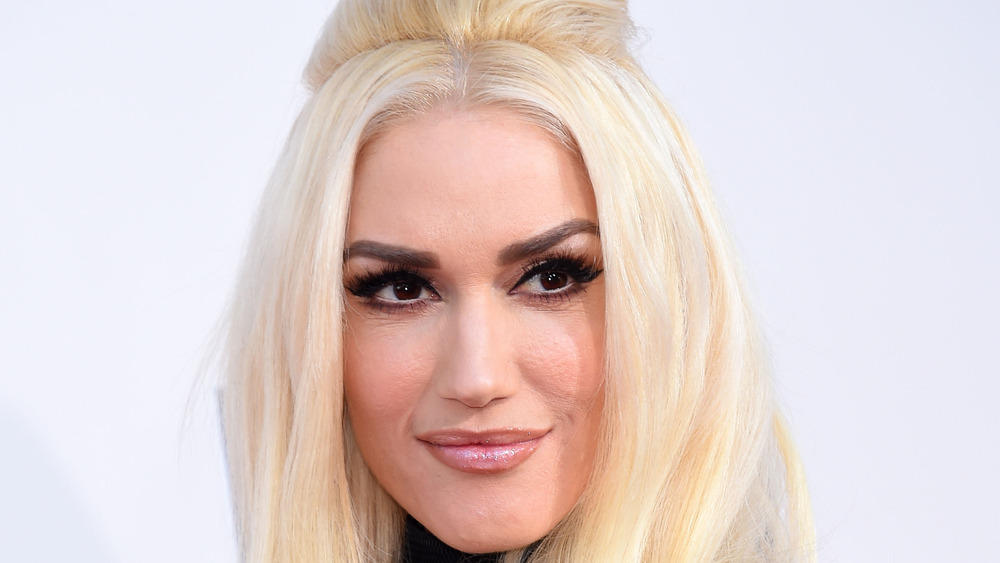 Gwen Stefani smiling looking to the right