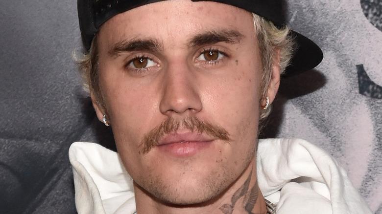 Justin Bieber backwards hat mustache