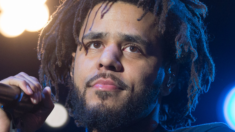 J. Cole while on stage
