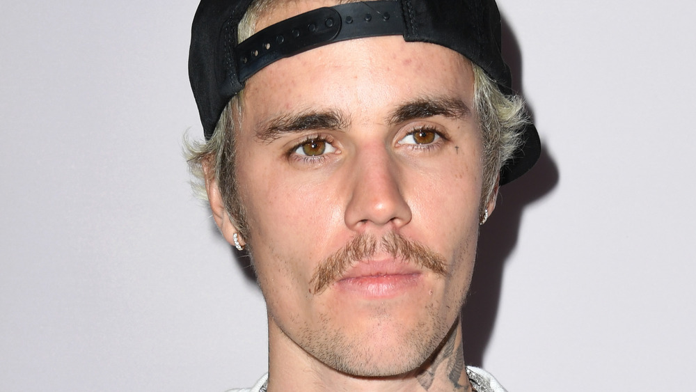 Bieber backwards cap and mustache