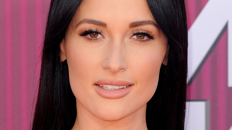 Kacey Musgraves smiling with nose piercing