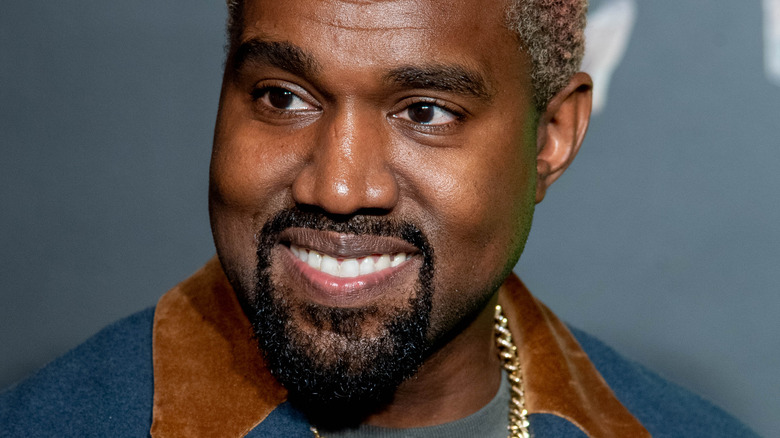 Kanye West smiling and looking to the side