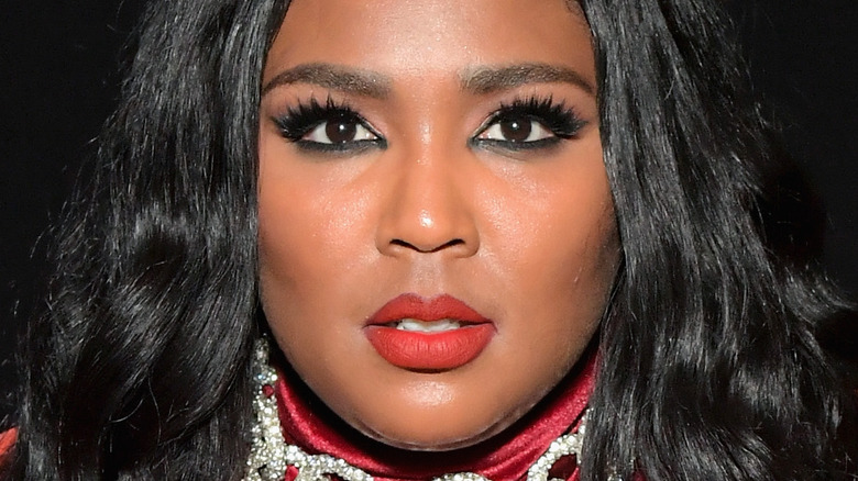 Lizzo with a serious expression