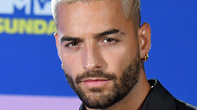 Maluma with a serious expression