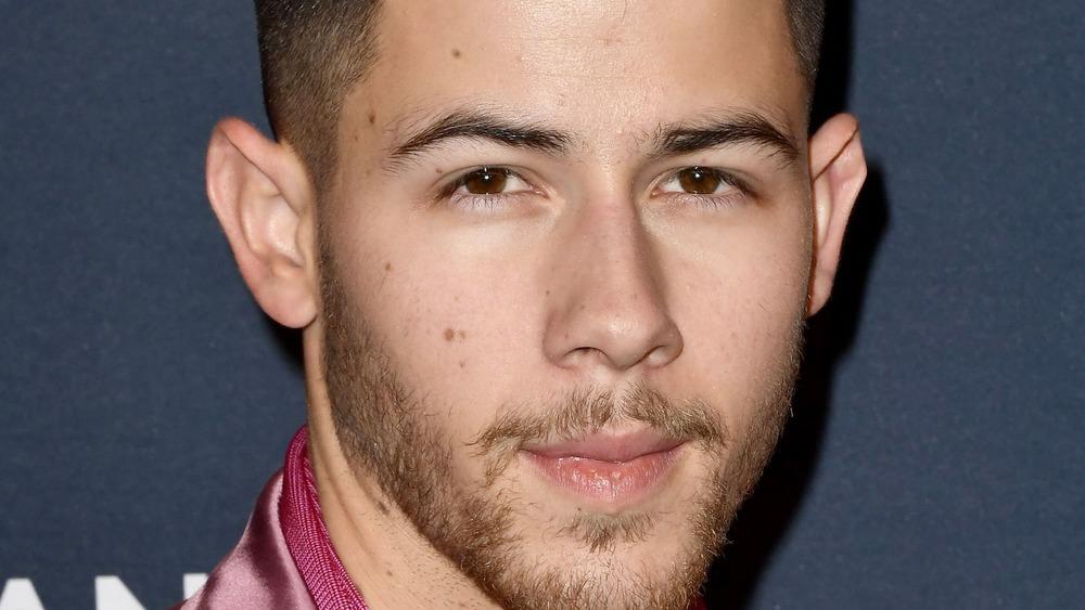 Nick Jonas poses