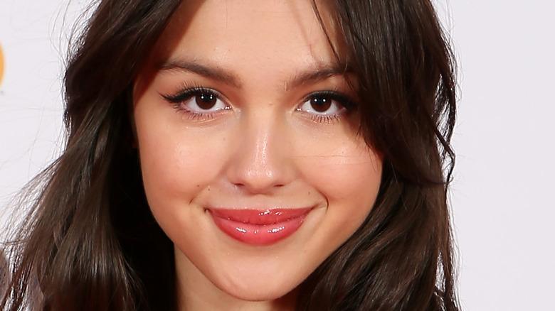 Olivia Rodrigo smiling at the Brit Awards