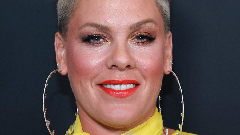 Pink wearing long earrings