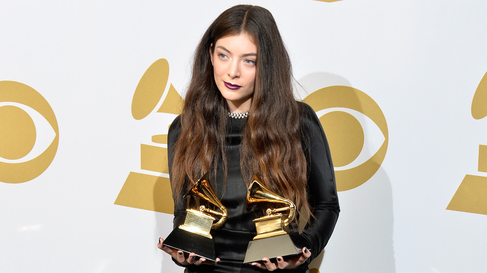 Lorde with Grammy Awards