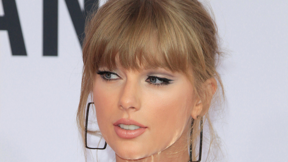 Taylor Swift gazes at the camera on the red carpet
