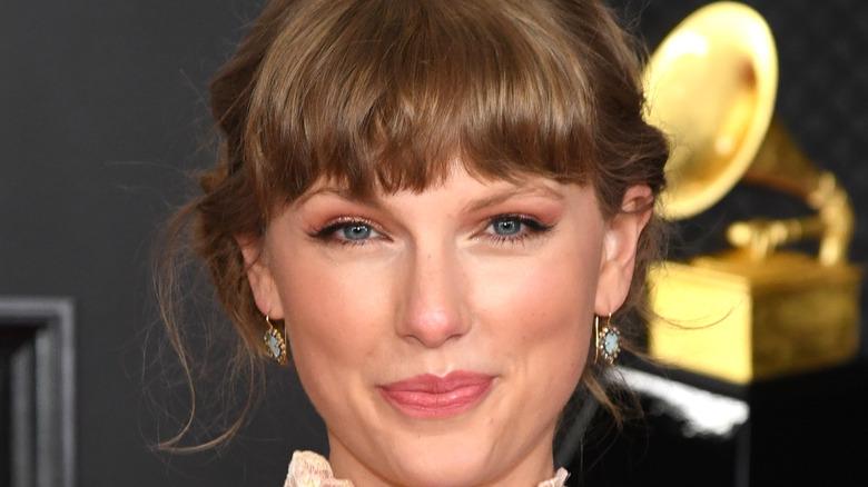 Taylor Swift smirking