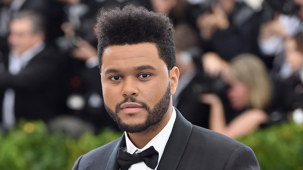 The Weeknd posing on red carpet