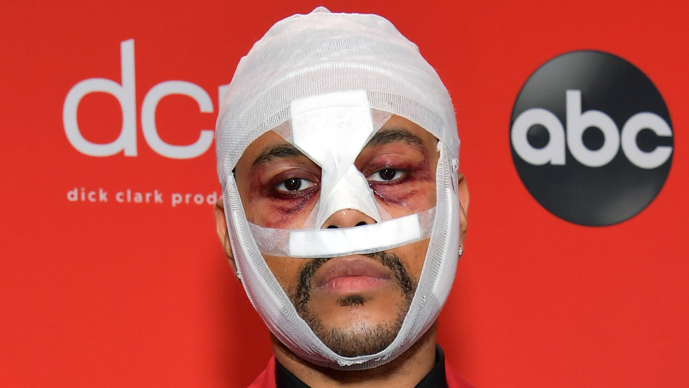 The Weeknd wearing face bandages