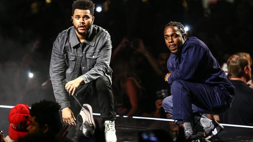 The Weeknd and Kendrick Lamar performing on-stage in 2017