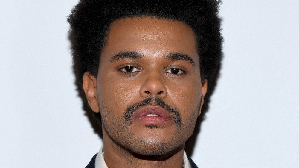 The Weeknd poseing