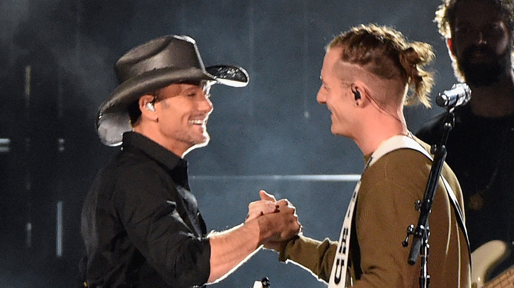 Tyler Hubbard and Tim McGraw perform onstage at the 2016 CMA awards