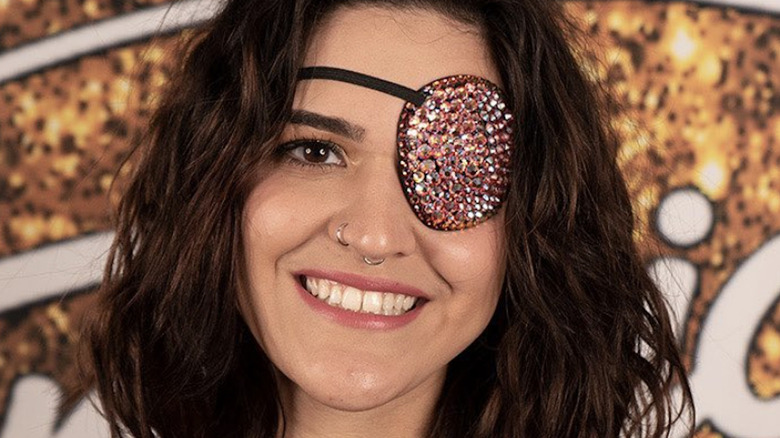 Andrea Valles wearing an eye patch