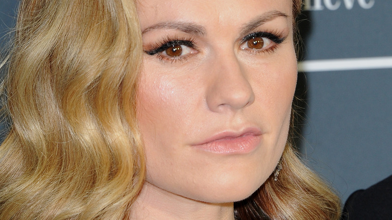 Anna Paquin with serious expression on red carpet
