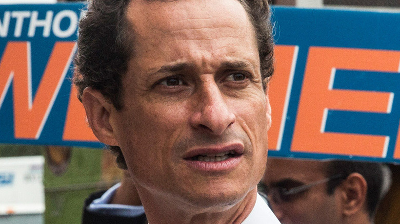 Anthony Weiner meets with people on a street corner In Harlem while campaigning in