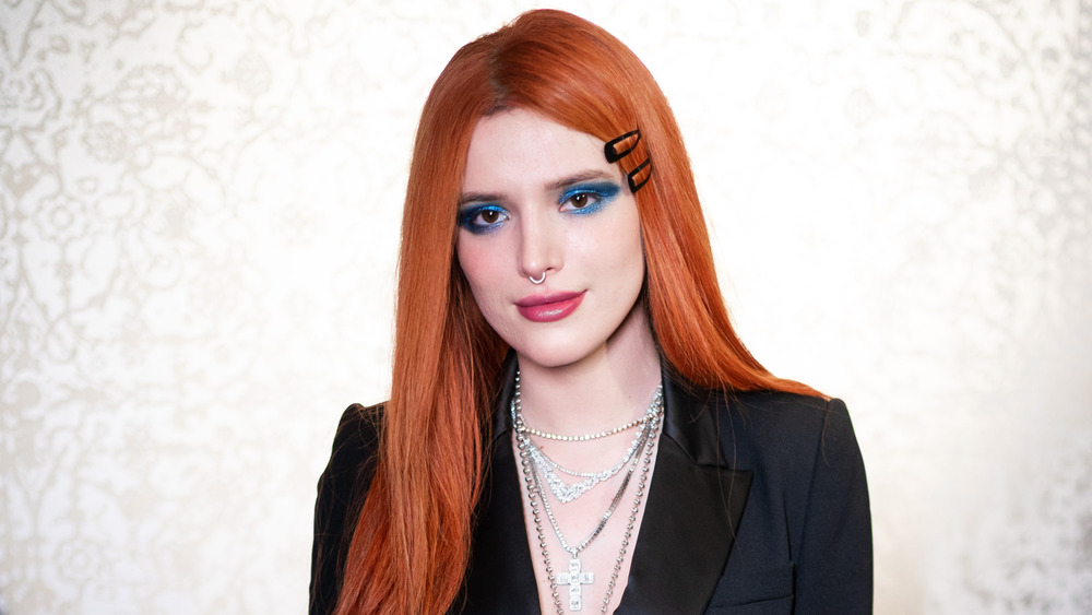 Bella Thorne with red hair and nose ring