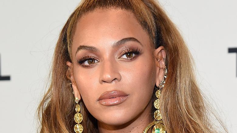 Beyonce wearing gold earrings