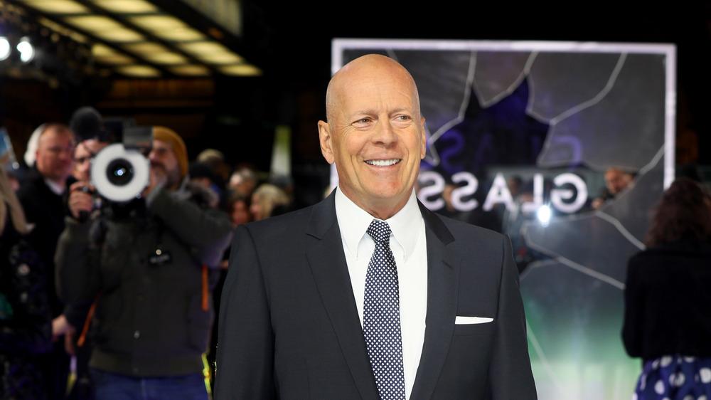 Bruce Willis smiles on red carpet