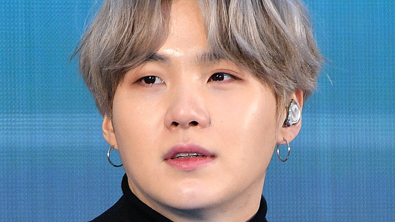 Suga from BTS gazing to the side