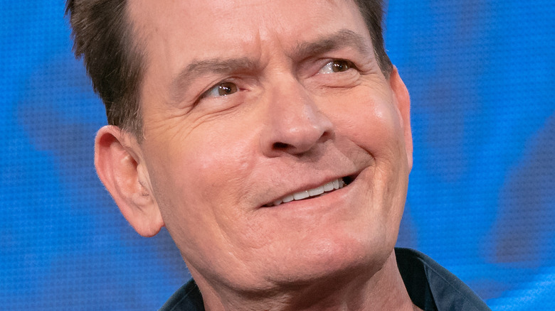 Charlie Sheen smiles at ComicCon