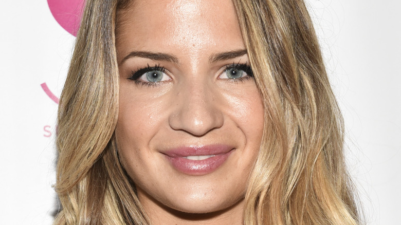 Naomie Olindo posing at step and repeat