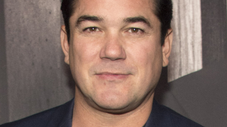 Dean Cain with slight smile on the red carpet