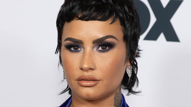 Demi Lovato poses on red carpet