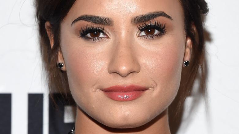 Demi Lovato with a slight smile