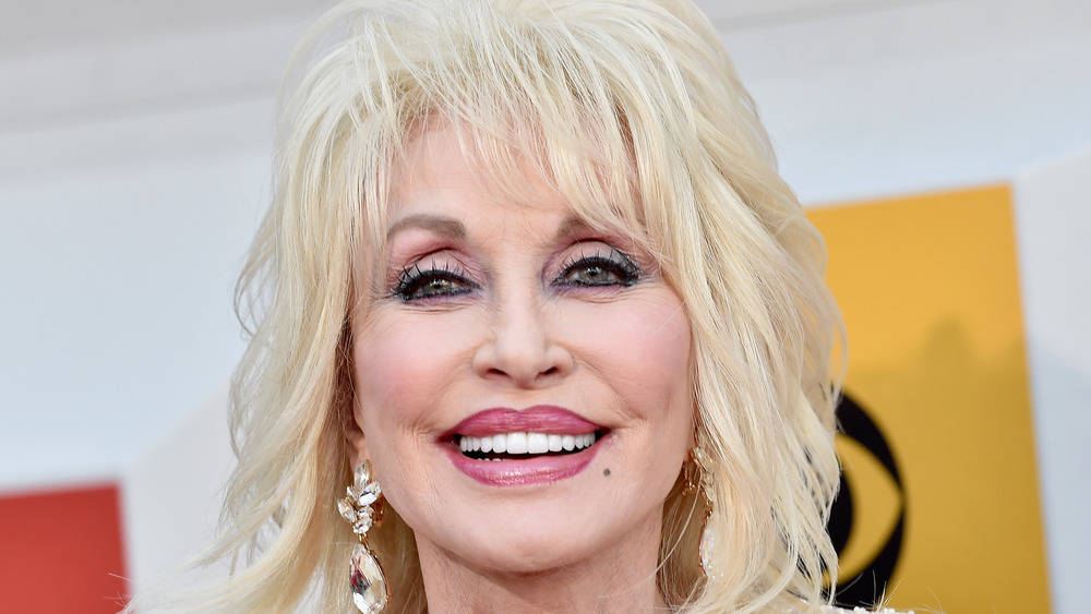 Dolly Parton smiling on the red carpet